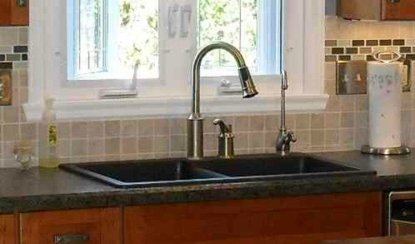 cast iron drop-in sink with a laminate counter surface