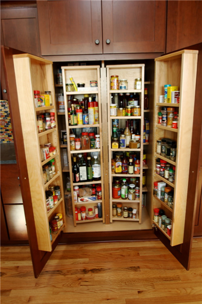 The homeowners enjoy cooking and are able to store supplies in a functional chef's pantry cabinet that keeps items organized and accessible.