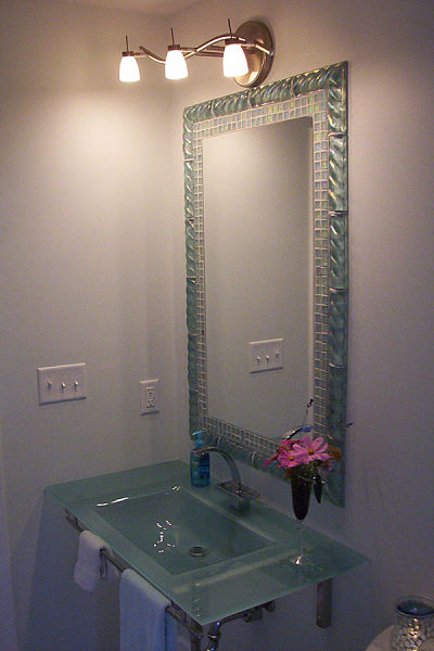 Half bath with tile frame mirror and wall-mount glass sink
