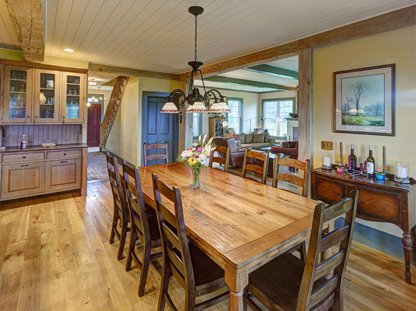 dining room with beam and beadboard ceiling