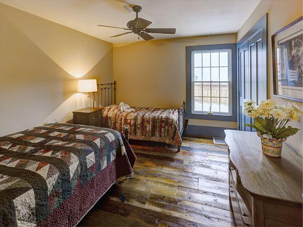 bedroom with rustic wood floors