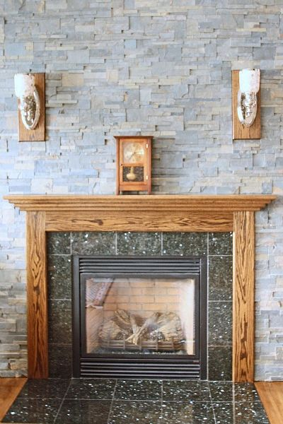 Fireplace with granite tile surround and hearth