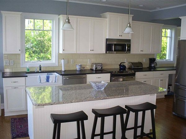 white farmhouse kitchen with granite island