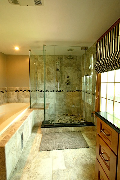 walk in shower with tiled soaking tub