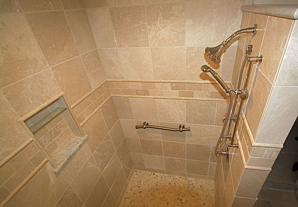 doorless walk-in shower with marble tile