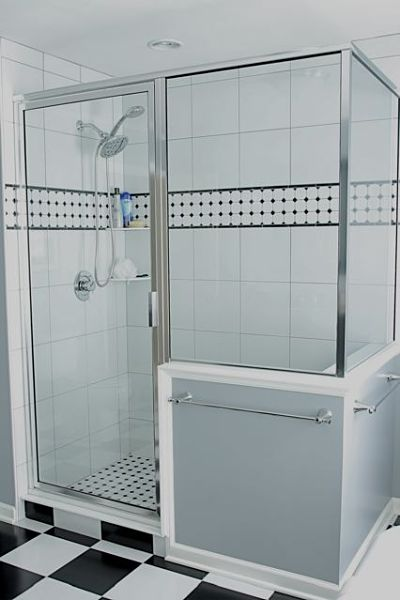 walk-in shower with hinged door and glass surround