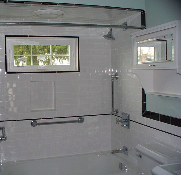 shower with white subway tile