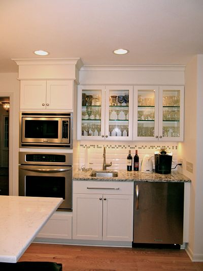 Kitchen bar area with in-cabinet and under-cabinet lighting
