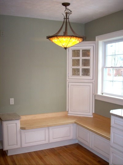 custom window seat and corner storage cabinet