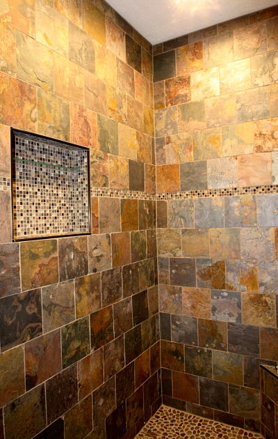 walk-in shower with stone tile design