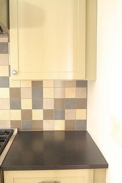 two-inch square kitchen backsplash tile