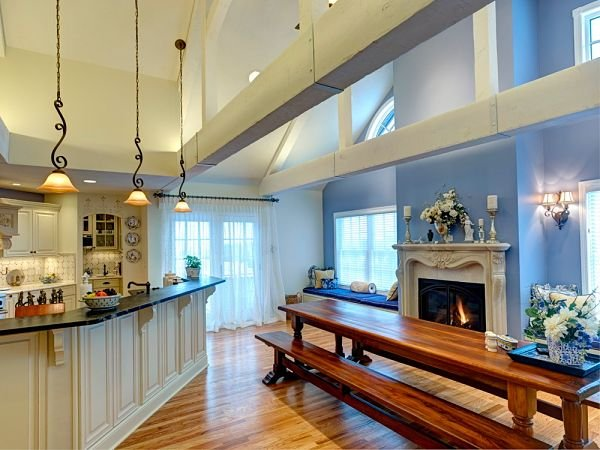 Kitchen addition with open dining area and stone fireplace mantel