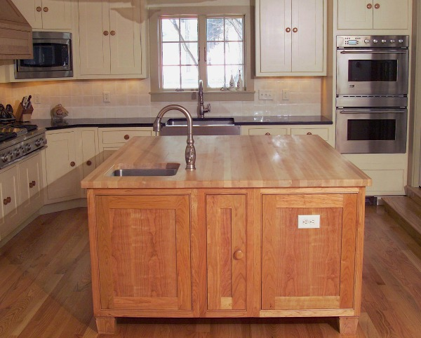 kitchen with farmhouse and island sinks