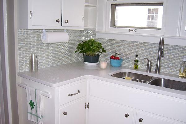 kitchen with glass tile backsplash