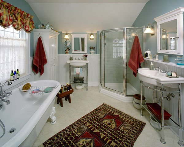 antique bathtub with corner shower