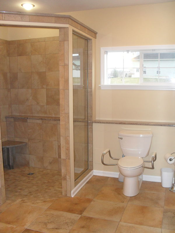 this nothreshold walkin shower was designed for an individual with compromised mobility universal design principles were applied