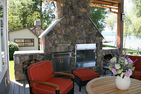 covered deck addition with stone fireplace