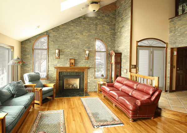 family room with stone veneer wall