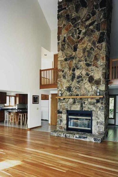 floor-to-ceiling stone fireplace