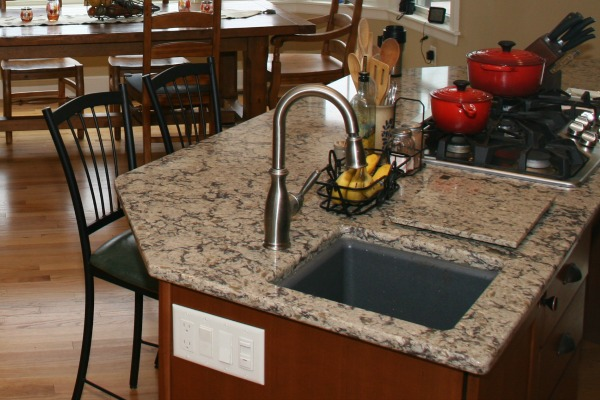 The main sink and island prep sink are undermount composite sinks