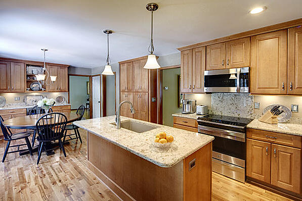 kitchen with island and maple cabinets