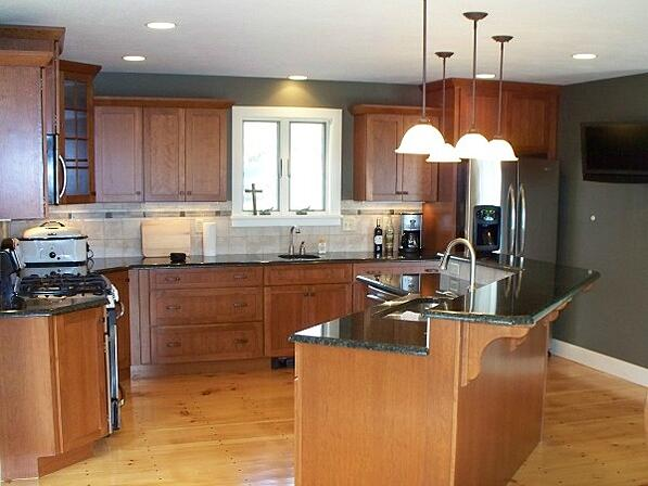 kitchen with tiered island and two sinks