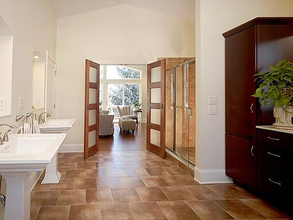 master bath with pedestal sinks and walk-in shower