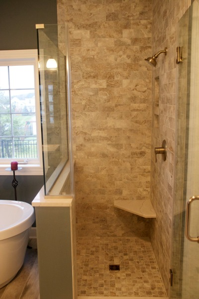 shower with glass enclosure and seat