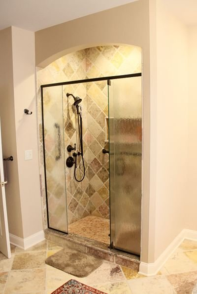 walk-in-shower-with-arch-and-decorative-tile.jpg