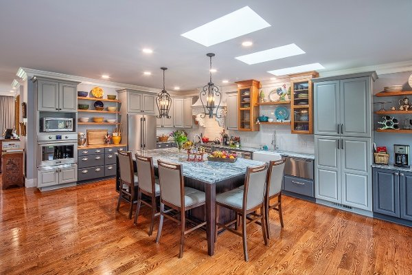 Open concept kitchen, with multiple colors and textures makes this space a piece of artwork in itself.