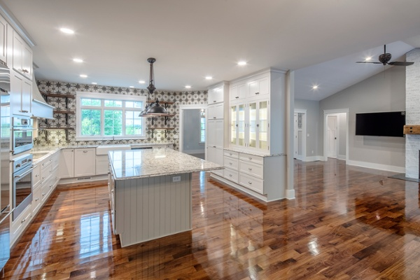 Authentic barn board open shelving paired with intricate tile patterns makes this kitchen and all its bells and whistles a place of perfection.