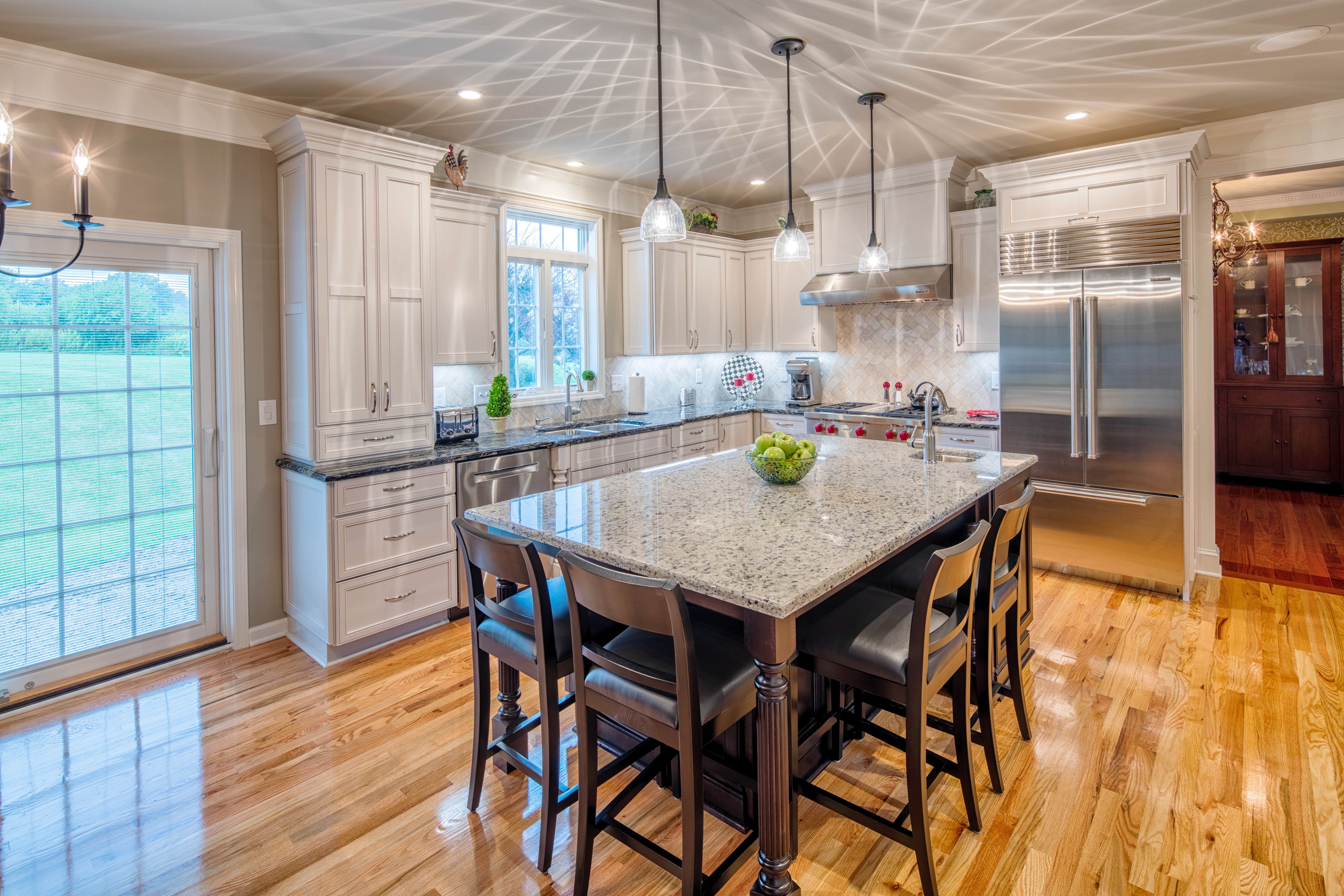 Bright lights, and complimenting Cambria counter tops and island. Spacious seating at the island and stainless steel appliances give this kitchen an easy flow and clean look.