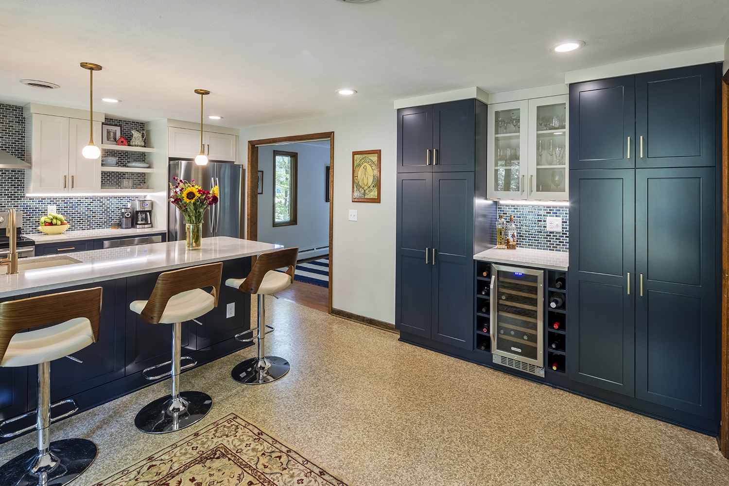 This kitchen gives the classic nautical theme an update! Making the most of the space with built in pantry storage and sleek modern seating at the hub of the kitchen.