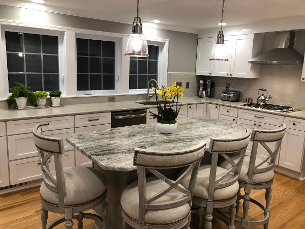 Bringing function, lighting and flow to this newly remodeled kitchen. Bright, light colors, with plenty of seating and room to move.