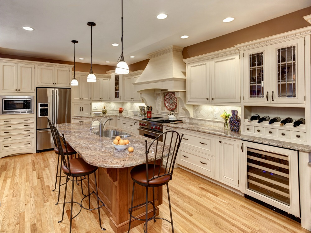 This L Shaped Kitchen Features Custom Cabinetry, A Large Island With Dual  Stainless Steel