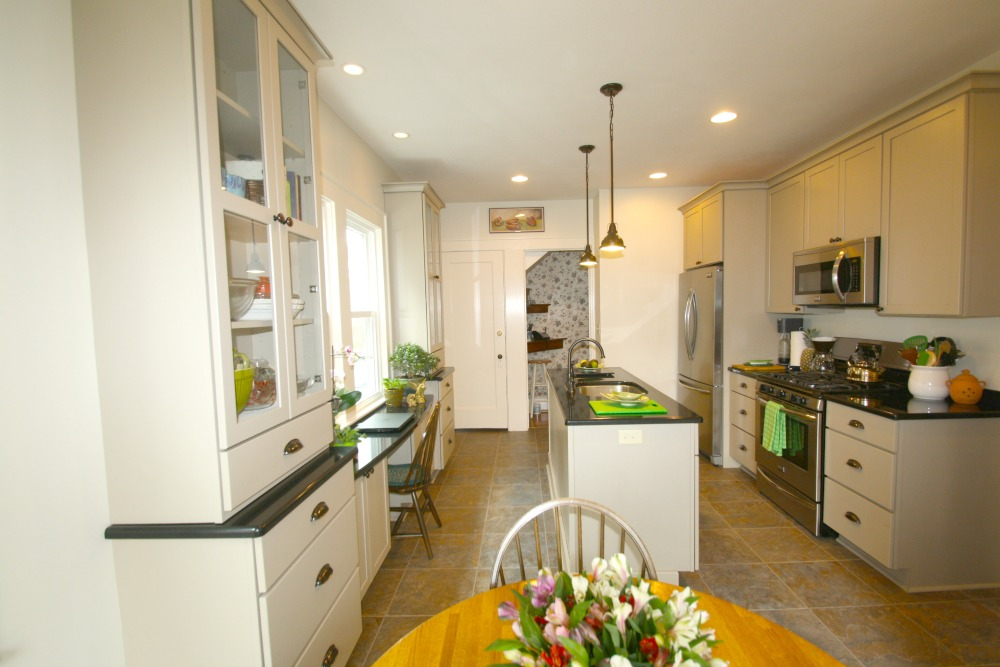 This Completely Remodeled Galley Kitchen Features An Island, Shaker Style  Cabinets, Stainless Steel