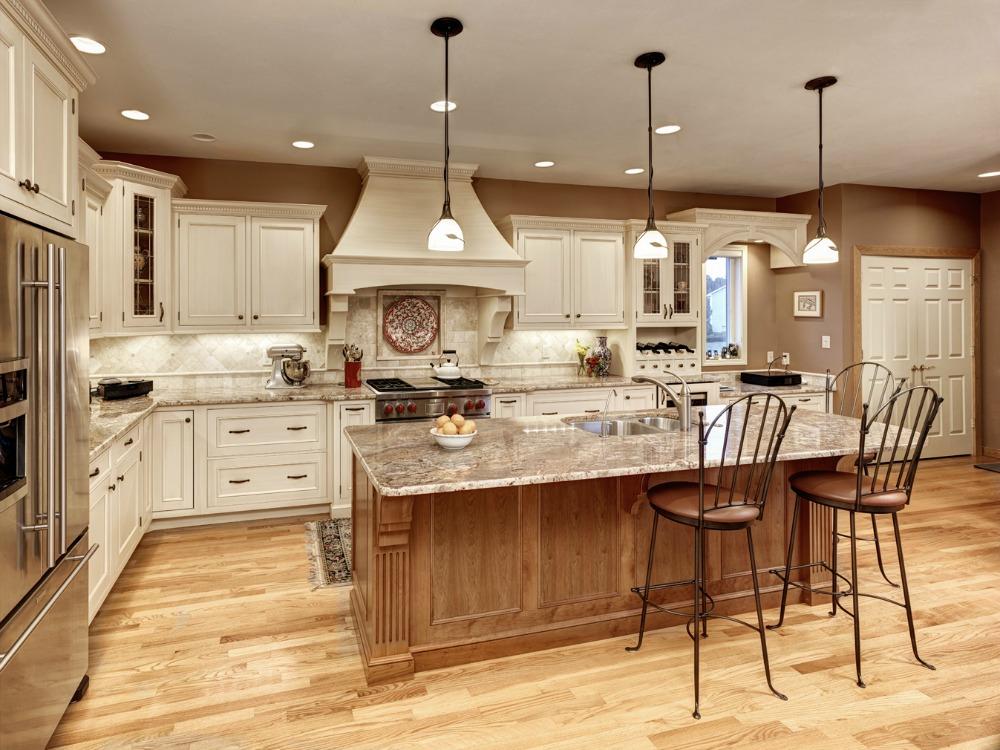 lighting over kitchen island. Three Decorative Pendant Lights Over The Large Island Add Interest To This Elegant Kitchen. Lighting Kitchen