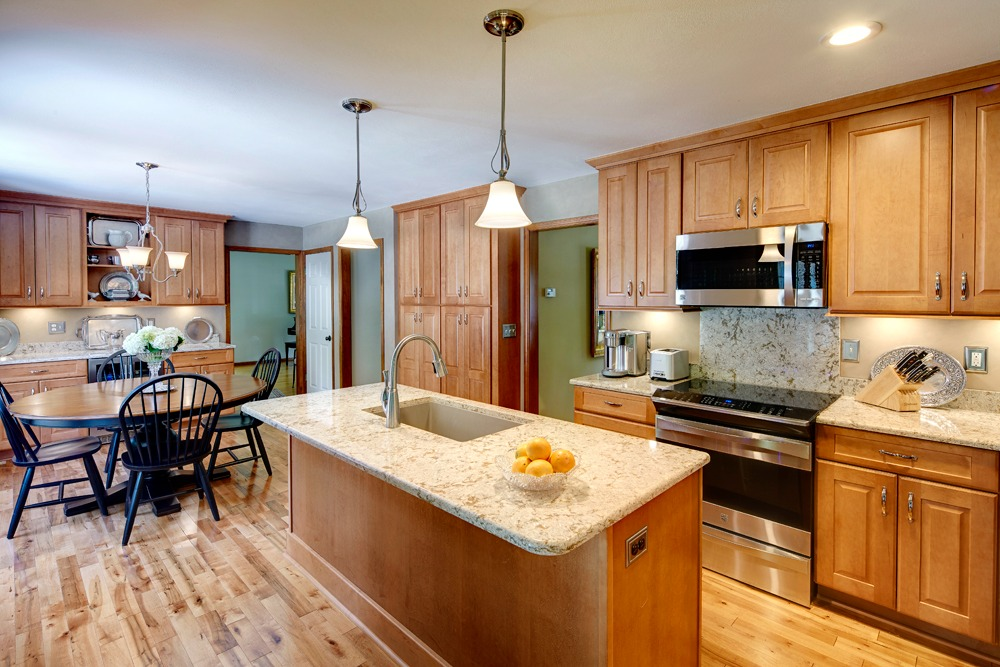 New Cabinetry Appliances Fixtures Quartz Counter Surfaces And Pre Finished Maple Wood