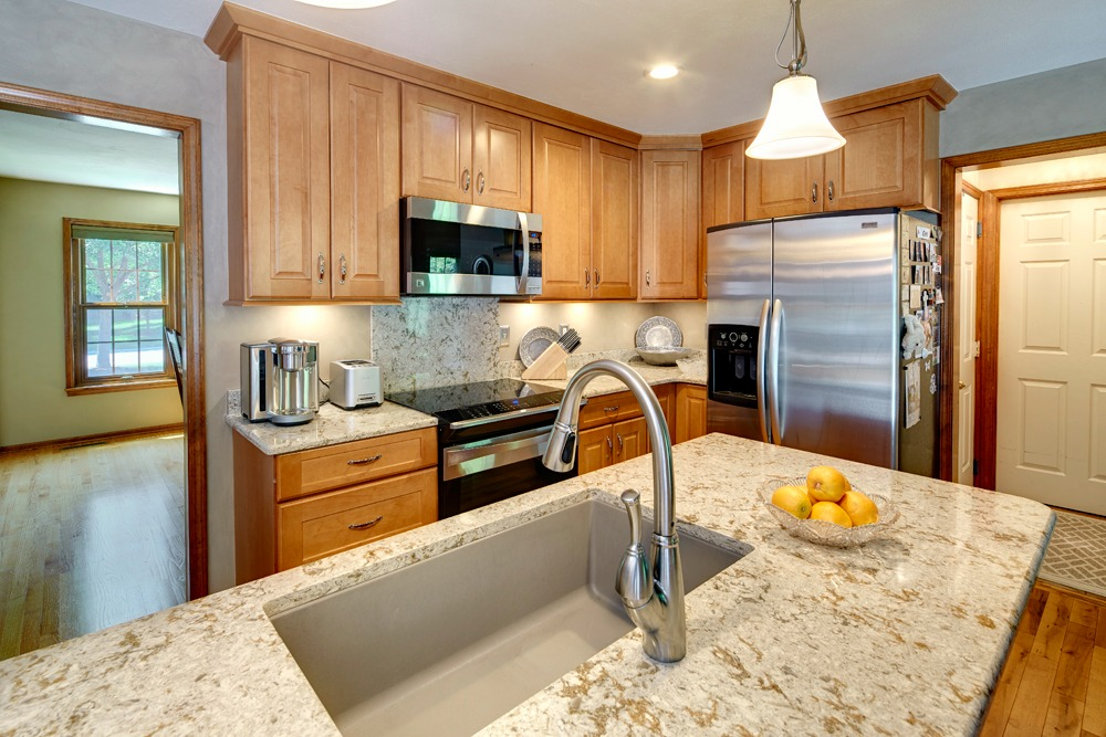 Countertops and the backsplash behind the stove are Cambria Quartz ...