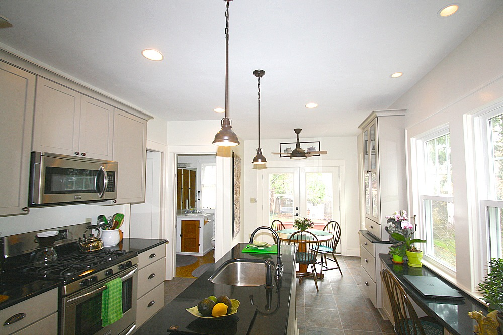 lighting in the kitchen includes the natural light provided by the double window and patio doors - Pendant Kitchen Lights Over Kitchen