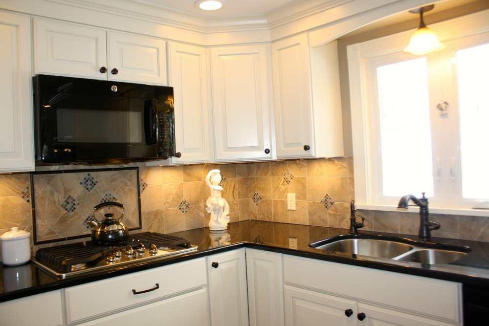 This backsplash design is practical, stylish and integrates cabinets, counters and fixtures.