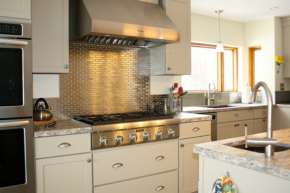 stainless steel mosaic tile in a subway tile pattern was used to create a focal point - Tile In The Kitchen