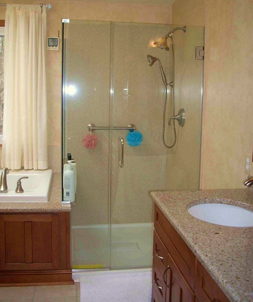 Showers can be enclosed entirely by custom cut glass making the shower seem open to the entire bathroom.