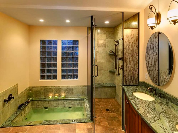 Another view of the glass shower enclosure with the door open. Note that the shower floor has no threshold.