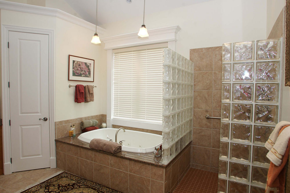 a spalike feel provides privacy and relaxation in this bathroom achieved by designing