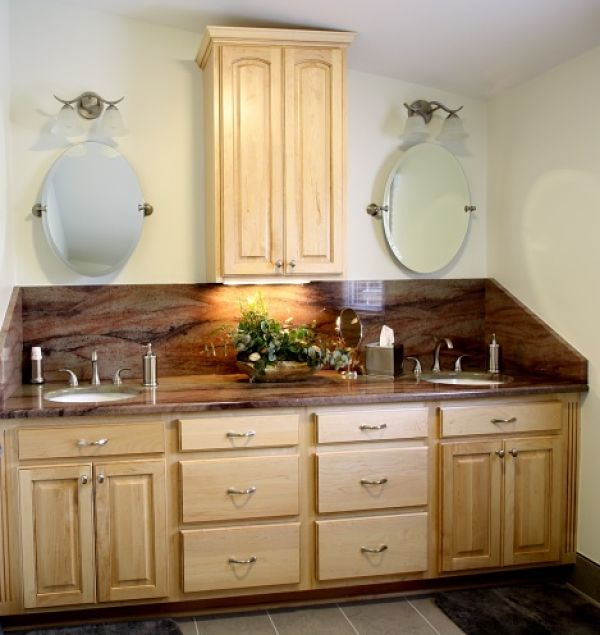 Double Sink Vanity With Granite Countertop. A stunning slab of granite was the inspiration for d cor in this  updated master bathroom Bathroom Vanity Storage Syracuse CNY Mirror Cabinets