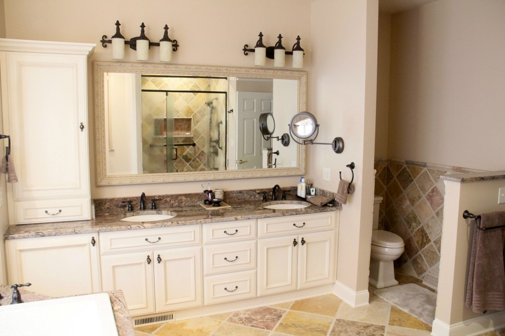 double sink vanity with center cabinet. This master bathroom retreat was remodeled with many custom features that  reflect the personal style of Bathroom Vanity Storage Syracuse CNY Mirror Cabinets