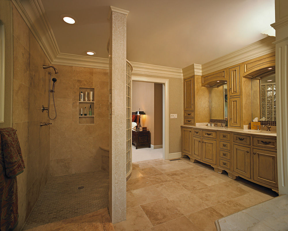 In this award winning master bathroom, a curved block wall separates the walk-in shower from the rest of the bathroom. The custom painted vanity continues the