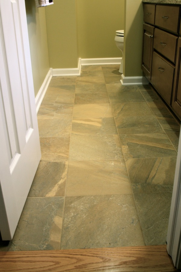 "The floor tile used in this master bath is ""Brown"" from the Olympia Tile ""High Rock Series"" and the grout is Laticrete ""Desert Khaki #56. The variegated colors look like natural stone."