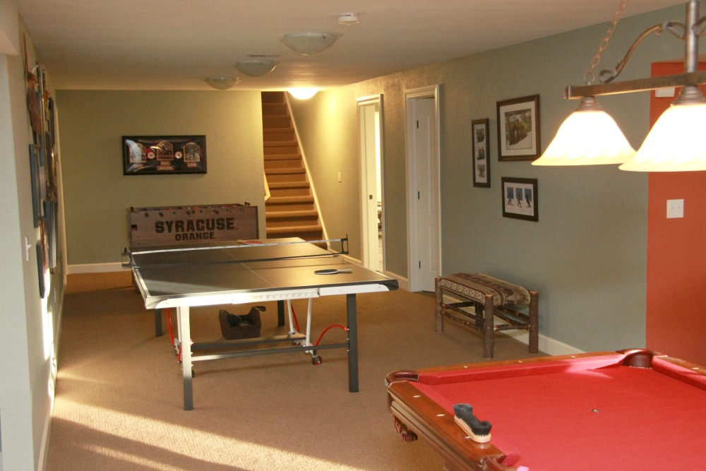 Basement remodeling contractors syracuse cny this lower level game room features a pool table and ping pong table three keyboard keysfo Choice Image